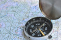 Correct navigation is the key to success magnetic compass lies on a topographic map Stock Photo