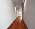 Corridor in a modern house, empty white walls Royalty Free Stock Photo