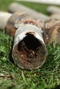 Corroded and blocked steel household pipes very old Stock Photo