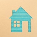 Corrugated cardboard a house cut out on a Royalty Free Stock Photography