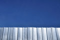 Corrugated iron sheet with blue sky Royalty Free Stock Photo