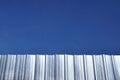 Corrugated iron sheet with blue sky Royalty Free Stock Photo