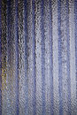 Corrugated and translucent glass of window purple colored Stock Photos