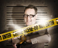 Corrupt business man behind crime scene tape Royalty Free Stock Photo