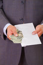 Corrupt politician put some money inside of an envelope Royalty Free Stock Photo