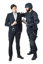 Corrupted businessman a being arrested by a swat agent Stock Images