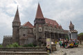 Corvin castle corvinesti or hunyadi castle a group of tourists in front of the corvins hunedoara transylvania romania Royalty Free Stock Photos