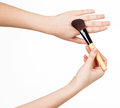 Cosmetic brush for makeup in  hands  women isolated on white. Royalty Free Stock Photo