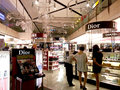 Cosmetic duty free outlet in airport shopping heaven Royalty Free Stock Images