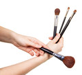 Cosmetic Makeup Brush in female hands isolated on white. Royalty Free Stock Photo