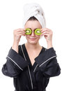 Cosmetic mask with fresh exotic fruits real young woman in a black bathrobe over a white background Stock Photography