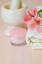Cosmetic moisturizing cream towels and  flower Royalty Free Stock Photo