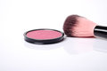 Cosmetic pink blush on and makeup brush. Royalty Free Stock Photo