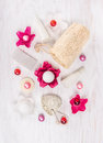 Cosmetic set for bath with perfume flowers salt and oil balls sponge pumice on whiten wooden background top view Stock Photography