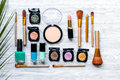 Cosmetic set with eye shadow on woman table background top view