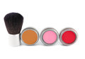 Cosmetics a blush brush and three different colors of blush Royalty Free Stock Photography