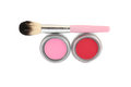 Cosmetics a blush brush and two different colors of makeup Stock Photography