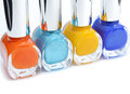 Cosmetics colorful nail polish on white background with copy space macro with shallow dof selective focus on turquoise Stock Photography