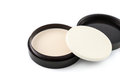 Cosmetics foundation makeup with sponge applicator over white Royalty Free Stock Photos