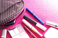 Cosmetics with a makeup bag on a pink background taken various against from high angle view lighted from the right rear the beauty Royalty Free Stock Photos