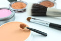 Cosmetics makeup and brushes on white background Royalty Free Stock Photography