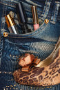 Cosmetics and perfumery sticks out of the pocket of his jeans Royalty Free Stock Photo