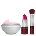Cosmetics set a lipstick a blush brush and a container of moisturizing cream Stock Photos