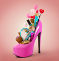 Cosmetics set into a woman s shoe fashion illustration Stock Photos