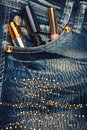 Cosmetics sticks out of the pocket of his jeans with rhinestones Royalty Free Stock Photo