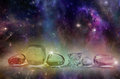 Cosmic healing crystals deep space background with colorful astral clouds stars suns and planets with a line of clear at the front Royalty Free Stock Photography