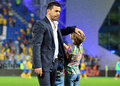 Cosmin contra in petrolul ploiesti swansea fc s coach consoles his daughter at the end of the europa league play off game between Stock Photo