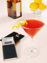 Cosmopolitan cocktail and cigarettes Stock Images