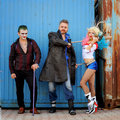 Cosplayer girl in Harley Quinn costume and cosplayer men in Joker and Boomerang Royalty Free Stock Photo
