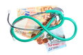 Cost of health care stethoscope on euro money medical treatment and high for a good service concept green paper banknotes isolated Stock Photo