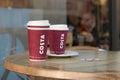 Costa coffee en la tabla de madera Foto de archivo libre de regalías