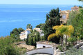 Costa del sol hillside with houses in sunny andalucia spain with blue ocean in the background Royalty Free Stock Photos