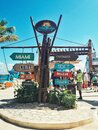 Costa Maya, Mexico - December 4, 2019: Arrow wooden authentic sign with Caribbean countries destinations at sea ocean, harbour.