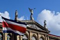 Costa rican flag a flying in front of a historic building in san jose s central avenue Royalty Free Stock Photography