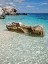 Costa smeralda of sardinia big rocks in the shallow emerald sea on a beach on the in italy Royalty Free Stock Image