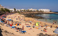 Costa teguise beach lanzarote canary islands holidaymakers on the at in summer Royalty Free Stock Photos