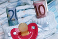 Costs for a baby shoes with pacifier and euro banknotes Royalty Free Stock Photography