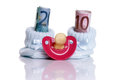 Costs for a baby shoes with teats and euro banknotes Stock Images