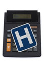 Costs of healthcare a black calculator on a white background with a hospital sign on it Stock Photography