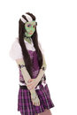 Costume girl black and white hair style green face this image has attached release Stock Photography
