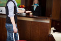 Costumer ringing bell at hotel counter male with baggage Royalty Free Stock Images