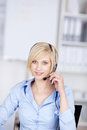 Costumer support executive wearing headset smiling with in office Royalty Free Stock Image