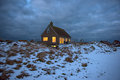 Cosy home in dark holiday dramatic clouds setting Royalty Free Stock Image