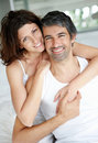 Cosy middle aged couple relaxing in bedroom Royalty Free Stock Photo