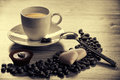 Cosy morning coffee wirh coffe beans and hearts shape chocolate Stock Photos