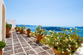 Cosy patio with flowers in Fira town on the island of Thera(Santorini), Greece. Royalty Free Stock Photo